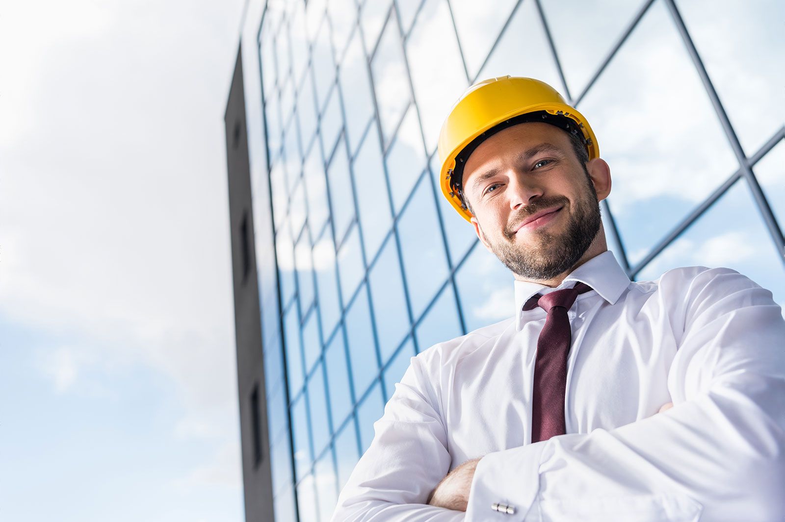 an engineer and his building on background